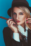 Portrait of sensual woman in hat with cigar Royalty Free Stock Photo