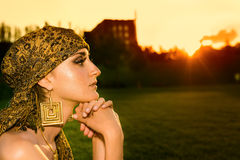 Portrait of sensual woman looking into the sunset. Portrait of sensual woman model with arabic bright makeup looking into the sunset Royalty Free Stock Photos