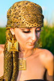 Portrait of sensual woman. Model with arabic bright makeup looking down Royalty Free Stock Photos