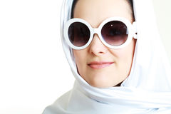 Arabian woman. Portrait of sensual woman model in sunglasses in white scarf Royalty Free Stock Photography