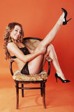 Portrait of sensual woman  sitting on a chair Royalty Free Stock Photos