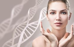 Portrait of sensual woman among white DNA chains. Portrait of sensual woman among white DNA chains over beige background Royalty Free Stock Images