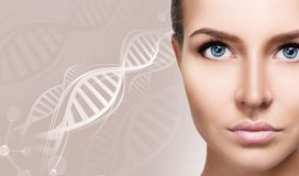 Portrait of sensual woman among white DNA chains. Over beige background royalty free stock images