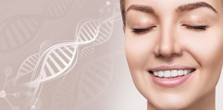Portrait of sensual woman among white DNA chains. Over beige background stock image