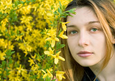 Portrait of sensual woman and yellow flowers. Portrait of a beatiful girl and yellow flowers as background Stock Images
