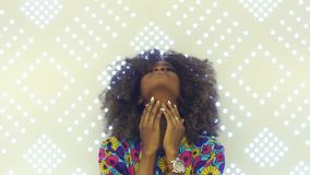 Portrait of a sensual young African woman looking at camera Pretty girl with afro hair touching her face. Beauty and stock footage