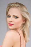 Portrait of a sensual young blond woman. Closeup portrait of a sensual young blond woman Royalty Free Stock Photography
