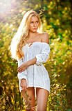 Portrait of a sensual young blonde female on field Stock Images