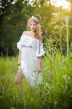 Portrait of a sensual young blonde female on field Royalty Free Stock Photography