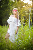 Portrait of a sensual young blonde female on field Royalty Free Stock Image