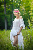 Portrait of a sensual young blonde female on field Stock Image