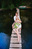 Portrait of a sensual young couple hugging on a wooden bridge. On a background of blue water, lifestyle, love, romance, relationships Stock Photo