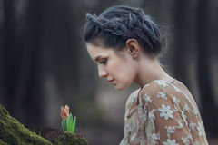 Portrait of sensual young woman wearing elegant dress in a coniferous forest. Portrait of sensual young woman wearing elegant dress in a coniferous forest Stock Images