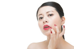 Portrait of sensuality glamour red lipstick asian women. Portrait of sensuality glamour red lipstick woman touch her lips with red nail polish finger, isolated Royalty Free Stock Photo
