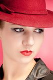 Portrait of sensuality stylish woman in red hat. Portrait of stylish woman in hat with bright red lips Stock Photography