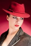 Portrait of sensuality stylish woman in red hat. Portrait of stylish woman in hat with bright red lips Royalty Free Stock Photo