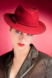 Portrait of sensuality stylish woman in red hat. Portrait of stylish woman in hat with bright red lips Stock Image