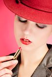 Portrait of sensuality stylish woman in red hat Stock Image
