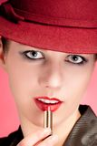 Portrait of sensuality stylish woman in red hat Royalty Free Stock Image