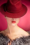Portrait of sensuality stylish woman in red hat. Portrait of stylish woman in hat with bright red lips Royalty Free Stock Photography