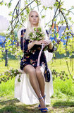 Portrait of Senxy Caucasian Blond With Bunch of Flowers Sitting Royalty Free Stock Image