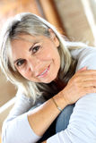 Portrait of serein woman at home. Portrait of senior woman relaxing at home Stock Photography