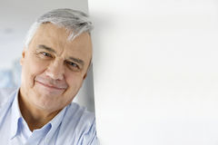 Portrait of serene man leaning head on the wall Stock Photo