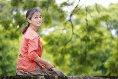 Portrait of serene mature woman in garden Stock Photography