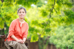 Portrait of serene mature woman in garden Royalty Free Stock Photography