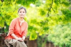 Portrait of serene mature woman in garden Stock Photos