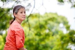 Portrait of serene mature woman in garden Stock Image