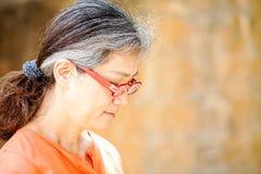 Portrait of serene mature woman in garden Stock Photo
