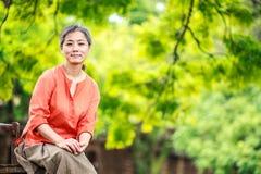 Portrait of serene mature woman in garden Stock Images