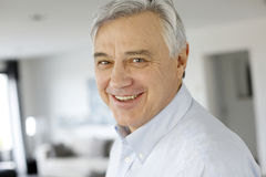 Portrait of serene smiling man at home Stock Images