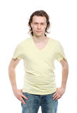 Portrait of serious adult man in shirt and jeans Royalty Free Stock Image
