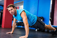 Portrait of serious athlete doing push-ups Stock Image