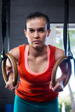 Portrait of serious athlete holding gymnastic rings Stock Photo