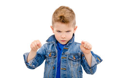 Portrait of a serious attractive boy pointing fingers Royalty Free Stock Image