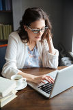 Portrait of a serious attractive mature business woman working Stock Image