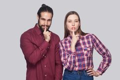 Portrait of serious bearded man and woman in casual style standi royalty free stock image