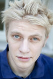 Portrait serious blond man with short hair royalty free stock photography
