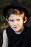 Portrait of a serious boy in a black hat Royalty Free Stock Photo