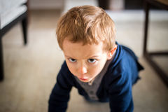 Portrait of serious boy playing at home Stock Photography