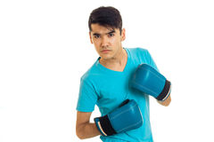Portrait of serious brunette boxer sportsman in blue gloves looking at the camera isolated on white background Royalty Free Stock Photo