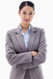 Portrait of a serious brunette businesswoman posing with the arm Stock Photos