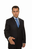 Portrait of a serious business man. With an open hand Royalty Free Stock Images