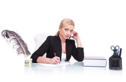 Portrait of serious business woman sitting on her desk. Stock Photo