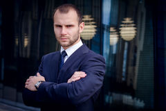 Portrait of serious businessman. On a background of office building Stock Photos