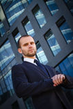 Portrait of serious businessman. On a background of office building Stock Image