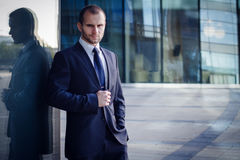 Portrait of serious businessman. On a background of office building Stock Photo